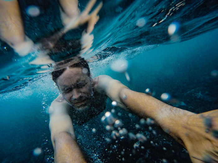 Man swimming in undersea