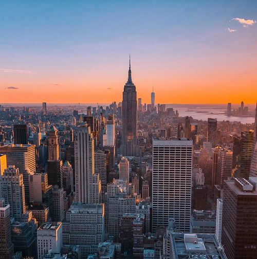 Aerial view of buildings in manhattan during sunset