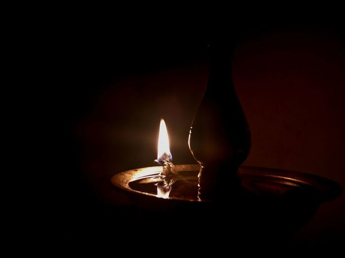 In..mY houSe..witH..tHy OwN..haNdS.. LigHt..tHe.LamP oF..tHy..LovE...💛... ... .... ..... ..... ......... .... ToucH..mE buT..OncE.. AnD I wiLl cHangE.. aLl mY cLaY ..inTo.. tHy..goLd..😊.. (taGoRe) No People Illuminated Black Background Close-up Flame Heat - Temperature Burning Oil Lamp Alone Colorful Atmospheric Mood Light And Shadow Exceptional Photographs First Eyeem Photo Expressions Scenics Flame Fine Art Waiting In My Point Of View Night Still Life Light And Reflection. EyeEm Masterclass EyeEm Gallery Welcome To Black