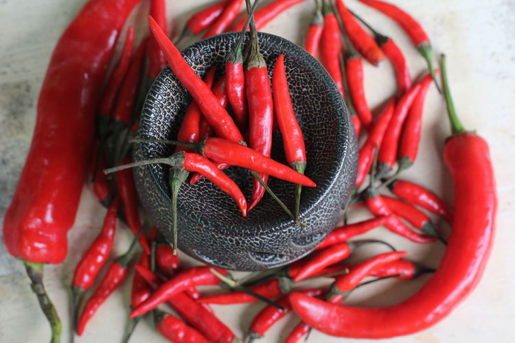 High angle view of red chili peppers on table