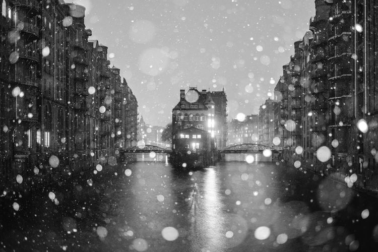 Illuminated city street during winter