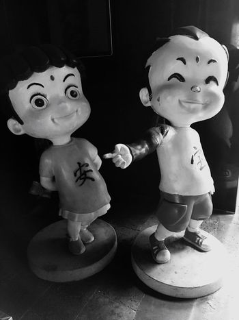 Chinese Cartoon Figures in Shenzhen China Chinese Food Figures Cartoon Sculpture China Shenzhen Boy Chinese Writing Chinese Design Funny Smiling Laughing Pointing Black And White Black And White Photography Silly Children People Anime Cartoonish