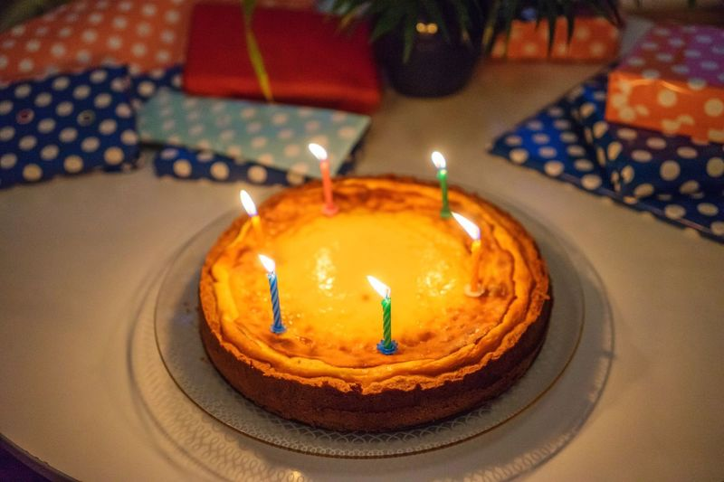 High angle view of lit candles on birthday cake