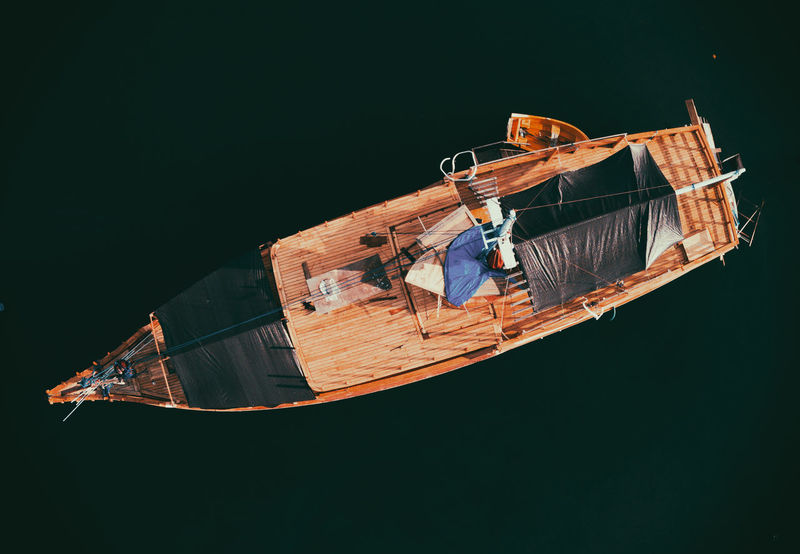 Aerial view of Wooden Boat anchored on shore Drone  Boat Day Fishing Boat Liveaboard Mode Of Transport Moored Nautical Vessel No People Outdoor Outdoors Sail Sailing Sea Traditional Boat Transportation Water Water Sports Wooden Yatch Be. Ready. EyeEmNewHere From My Point Of View Drone  Scenics Perspectives On People AI Now EyeEm Ready