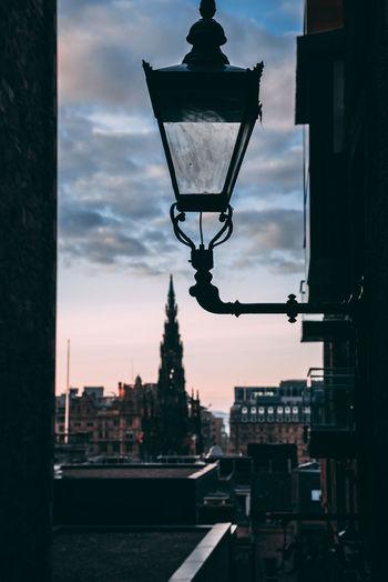 Street light and buildings against sky