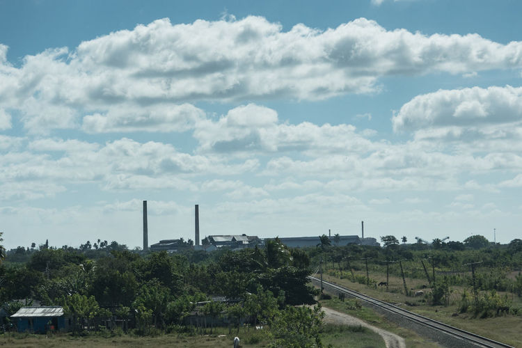 Sugar Mill in the east Architecture Bridge - Man Made Structure Cloud - Sky Cuba Cuba Collection Day Nature No People On The Road Again Outdoors Railway Track Sky Sugar Mill Travelling Photography Tree