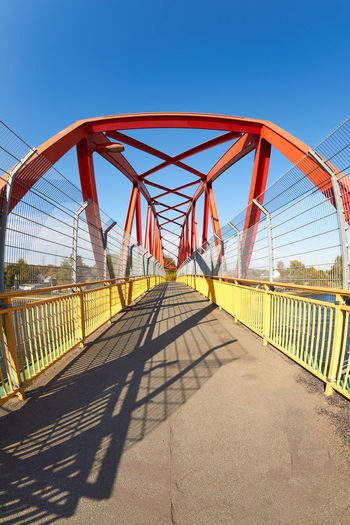footbridge Footbridge Architecture Blue Bridge Bridge - Man Made Structure Built Structure Clear Sky Connection Day Diminishing Perspective Direction Metal Nature No People Outdoors Railing Shadow Sky Sunlight The Way Forward Transportation