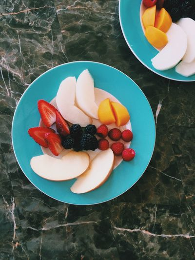 High angle view of appetizing fruits in plate