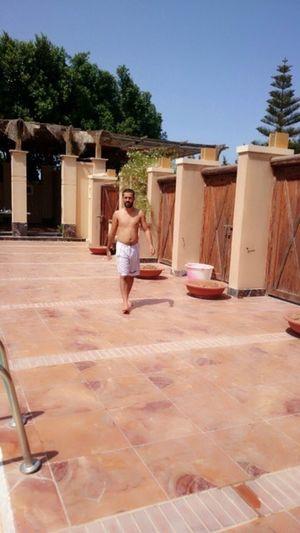 Libya Enjoying The Sun Swimming