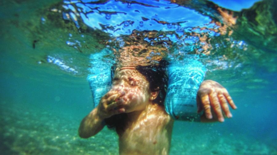 Underwater View Of Young Girl