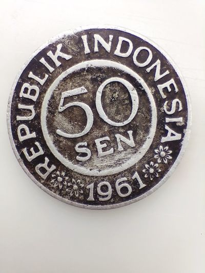 50 cents of Indonesian coins in 1961 INDONESIA Coins Money 1961 Shope Pattern Circle Close-up Clock Face Ancient Civilization Ancient Egyptian Culture Civilization Minute Hand Clock Hand Second Hand Astronomical Clock Non-western Script Roman Numeral Hour Hand Archaeology Ancient Instrument Of Time Ancient Rome Amphitheater