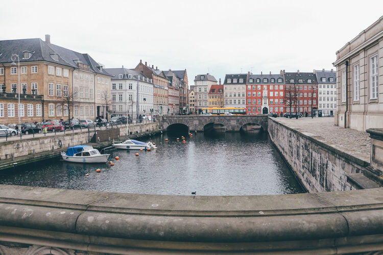 Architecture Bridge - Man Made Structure Building Exterior Built Structure Canal City City Life Cityscape Copenhagen Copenhagen, Denmark Day Gondola - Traditional Boat Gondolier Nautical Vessel No People Outdoors Sky Travel Destinations Water