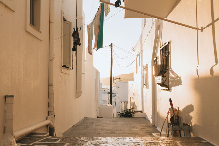 Wandering back alleys in Ios Greece at golden hour while on a sailing tour of the Cyclades islands stunning sunset. What an incredible sunset this was. Quiet and quaint and very much so local Greek life. Architecture Beautiful Cyclades Day Domestic Life Golden Hour Greece Greek Greek Islands Ios Local Naxos No People Outdoors Peaceful Setting Sun Shadows Shadows & Lights Sunset Sunset_collection Tourism Travel Traveling Wandering