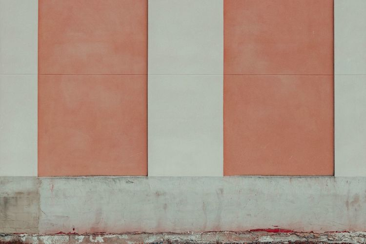 A coloured wall of a building