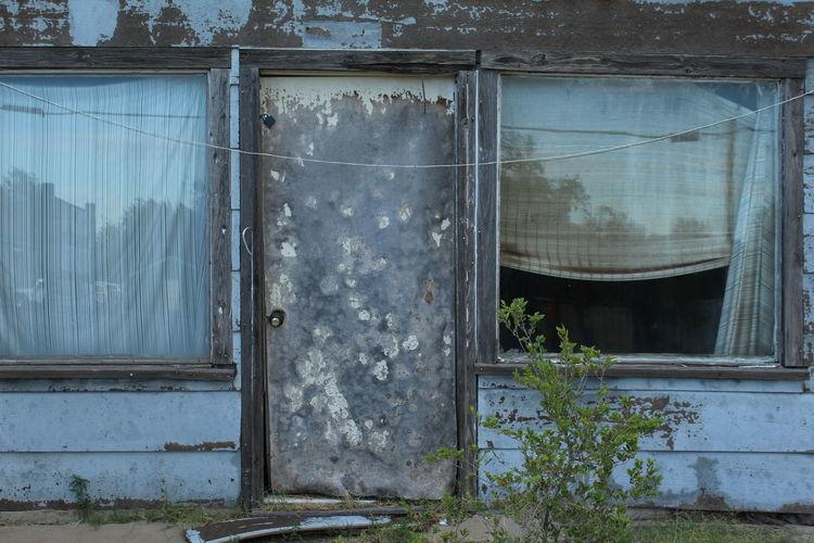 Damaged door in abandoned building