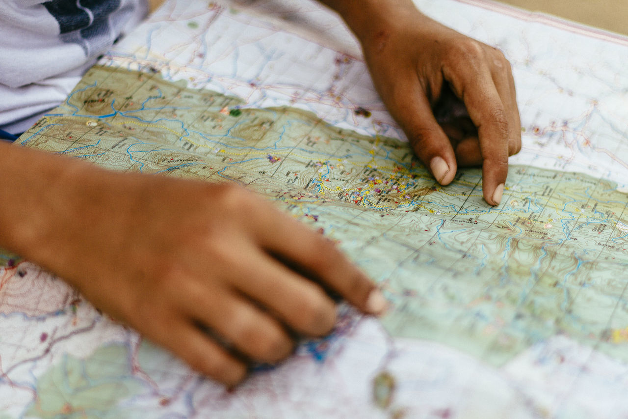 Cropped hands of man with map