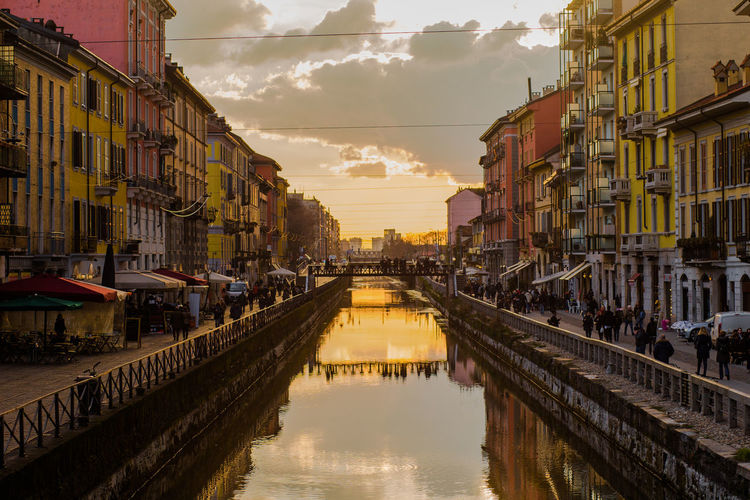 Panoramic View Of Canal In City Against Sky