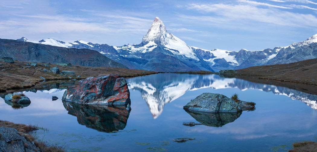 Matterhorn at sunrise reflected in Stellisee lake. Alps Beauty In Nature Lake Landscape Matterhorn  Mountain Mountain Range Nature Outdoors Panorama Reflection Reflection Lake Snow Switzerland