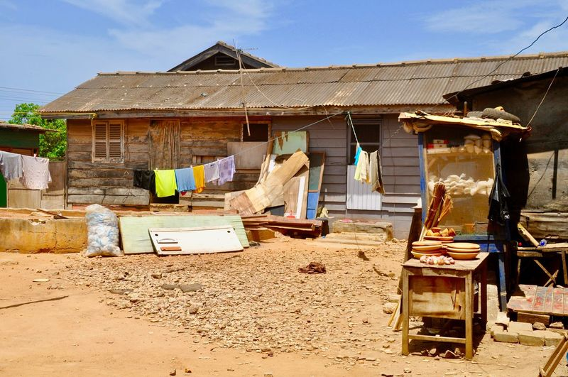 Bad Condition Ghana Messy Shanty Town A Mess Africa Building Built Structure Clothing Damaged Hanging House Hut Huts No People Poverty Residential District Roof Shack Shanty Shantytown Slum Social Issue Wood - Material
