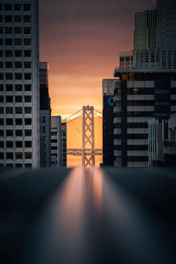 Bay bridge city sunset view