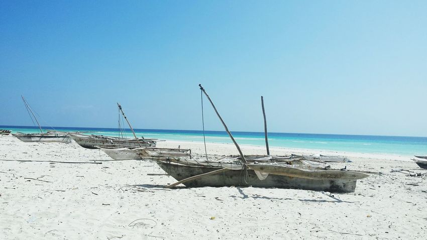Sea Beach Horizon Over Water Water Blue Indianocean Tanzania Zanzibarisland Polepole Hakuna Matata Clear Sky Sky Tranquil Scene Outdoors No People Day Fishing Boats Fishing Village tranquility Sand Nature Beauty In Nature Nautical Vessel
