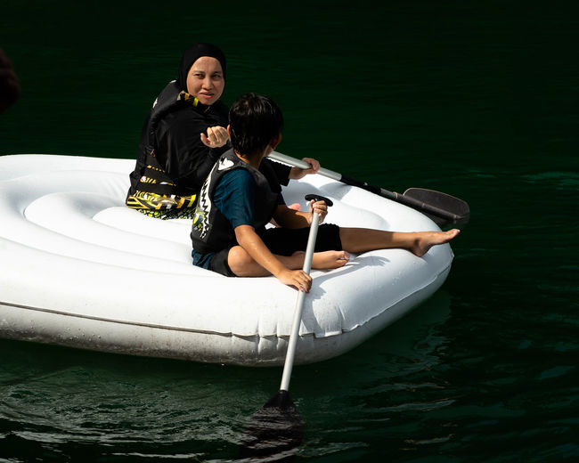 Man and woman in boat on lake