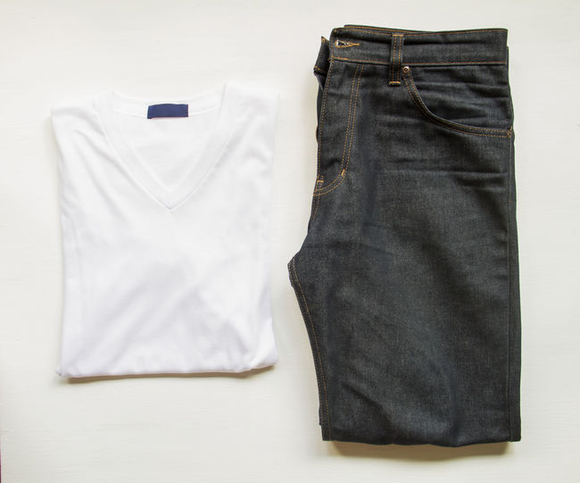 Directly Above Shot Of Jeans And T-Shirt Over White Background