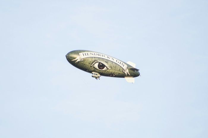 Blimp flying over the city. Blimp Hendricks Gin Hanging Out Taking Photos NYC Photography Jersey City