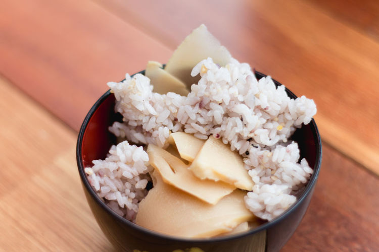 High angle view of ice takenori gohan in bowl on table in japan