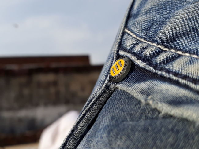 Check This Out Denim Bookeh Effect Button Outdoors No People Day Communication Text Close-up