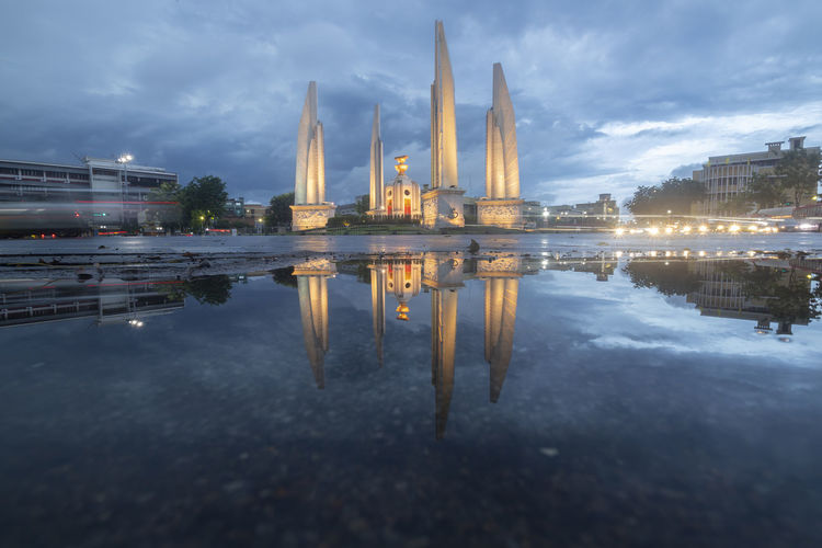 Reflection of illuminated buildings in water at dusk