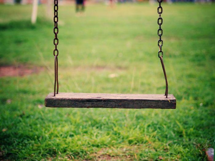 Close-up of swing on playground