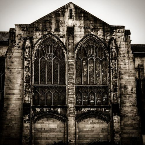 Occupational Calling No People Built Structure Entrance Arch Place Of Worship Architecture Sky Outdoors Day Cathedral Window Cathedral Atmospheric Black & White Place Of Worship Church Churchporn Church Architecture Building Exterior Dilapidated Dilapidation Dilapidated Building Atmospheric Mood Dilapitated Ruinous Weather Beaten