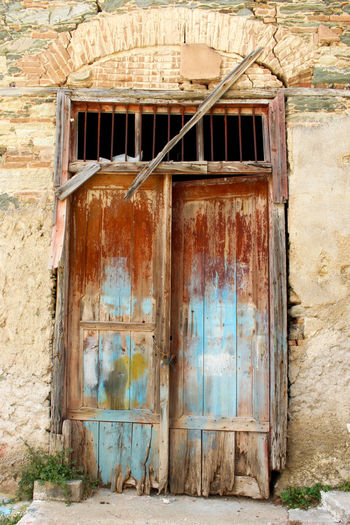 Architecture Bad Condition Blue Door Building Exterior Built Structure Closed Damaged Day Deterioration Door Exterior Greece House Lesbos Lesvos No People Obsolete Old Residential Structure Run-down Rust Rusty Rustygoodness Weathered