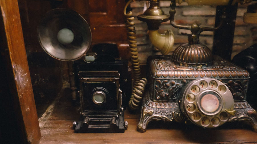 Close-Up Of Vintage Camera And Rotary Phone