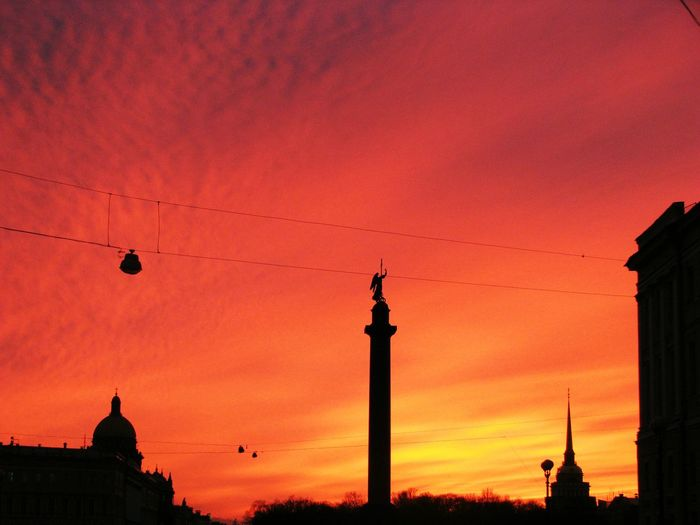 Low Angle View Of Alexander Column And Church Against Sky During Sunset