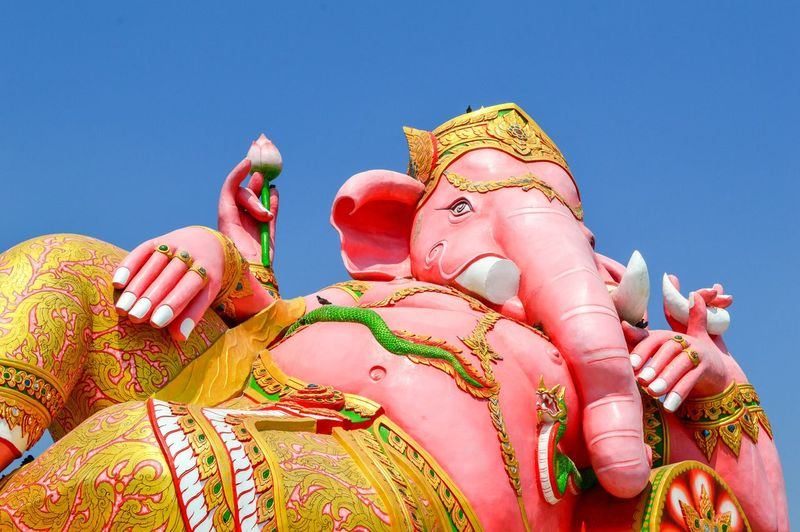 Low angle view of lord ganesha against sky