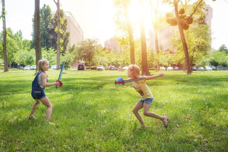 Children playing on grassy field