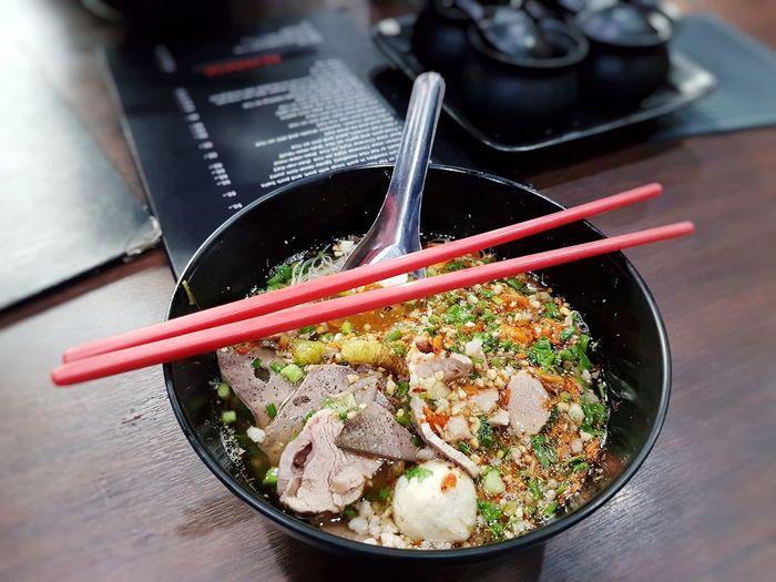 High angle view of thai noodles in bowl on table