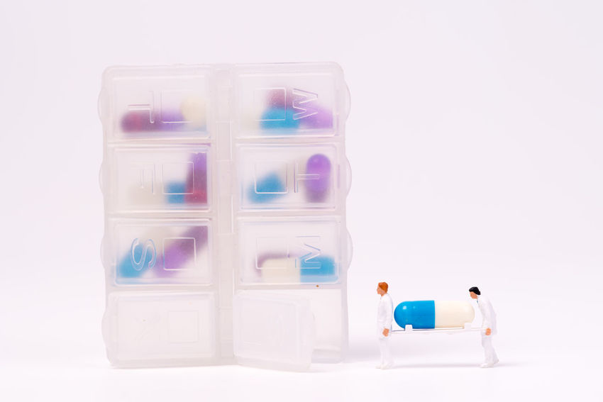 miniature people and medical drug container daily Doctor  Drug Hospital Therapy Antibiotic Box Capsule Close-up Container Diary Figurine  Healthcare And Medicine Illness Medical Patient Phamaceutical Pill Studio Shot Toy Treatment White Background