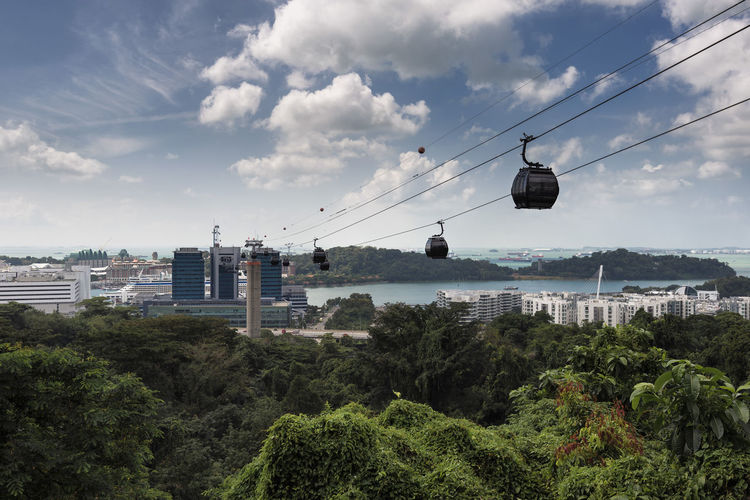 Singapore Cable Car from Mt. Faber to Sentosa Island ASIA Harbourfront Sentosa Singapore Singapore View Travel Travel Photography Architecture Building Exterior Built Structure Cable City Cityscape Crossing Hanging Island Mount Faber Nature Ocean Outdoors Overhead Cable Car Sky Southeast Asia Tree Water