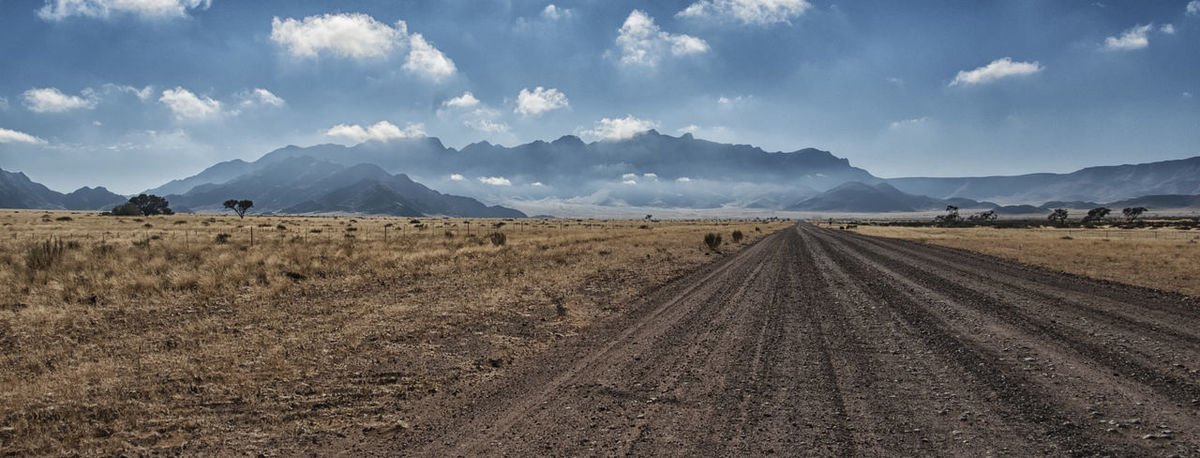 Africa Beauty In Nature Cloud - Sky Clouds Come From There Day Gravel Gravel Road Landscape Looking Back Morning Light Mountain Mountain Range Namib Naukluft National Park Namibia Nature No People Outdoors Road Scenics Sky Tranquility