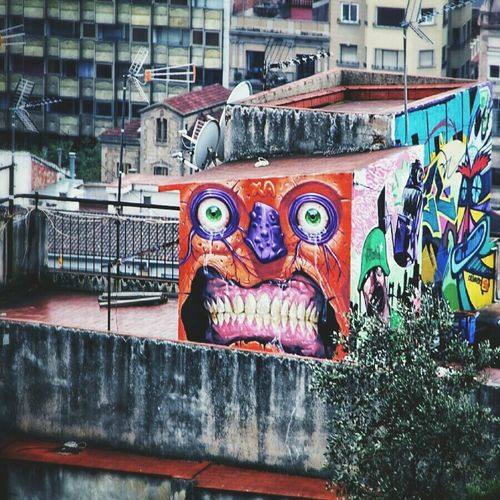 Barcelona! Some crazy art out there. Such a fun place to explore. Building Exterior Multi Colored Graffiti No People Outdoors Art Is Everywhere EyeEm Diversity Architecture Barcelona Spaın Travel Streamzoofamily