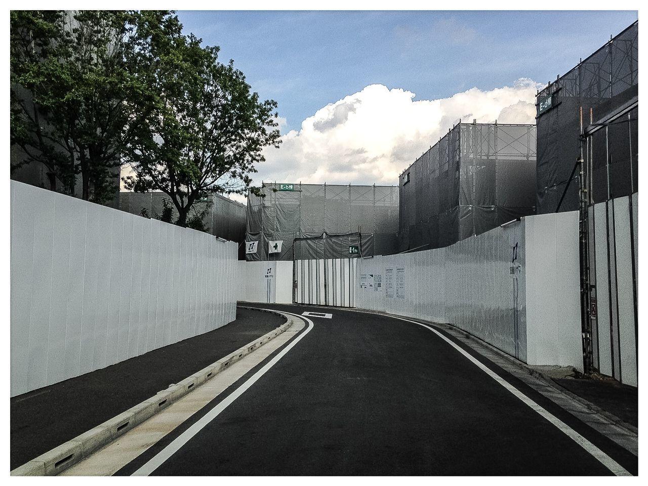 Street Amidst Under Construction Buildings Against Sky