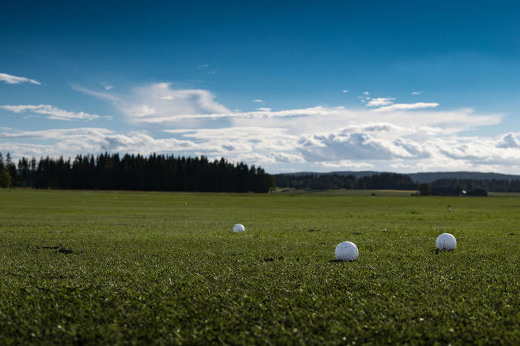 Beauty In Nature Blue Cloud Cloud - Sky Day Field Golf Golfball Grass Grassy Green Green Color Idyllic Landscape Meadow Nature No People Non-urban Scene Outdoors Scenics Sky Sport Tranquil Scene Tranquility