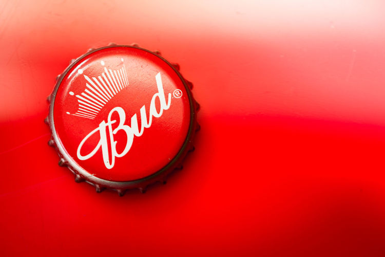 Alcohol American Culture Americana Bottle Cap Brand Brewery Bud Budweiser Close-up Copy Space Drink Food And Drink Indoors  King Of Beers Lager Marketing No People Red Reflection Refreshing Refreshment Text USA