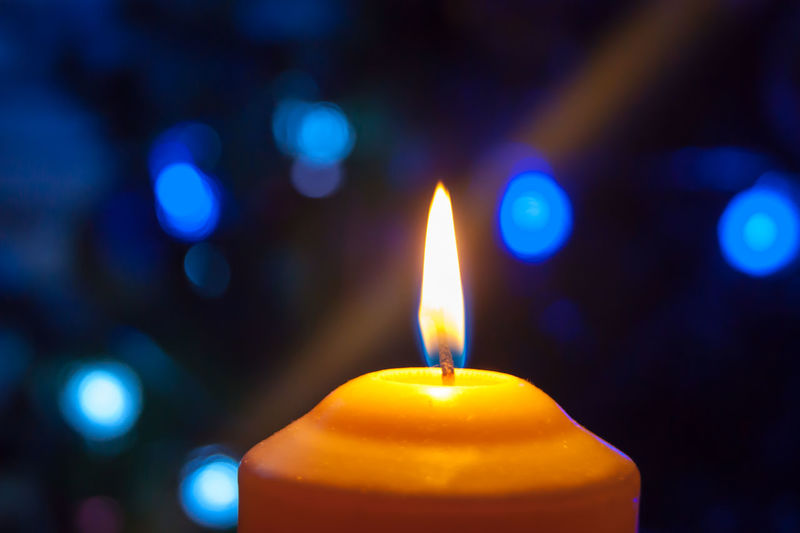 Close-up of illuminated candle
