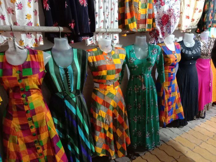 Dresses on mannequins at market