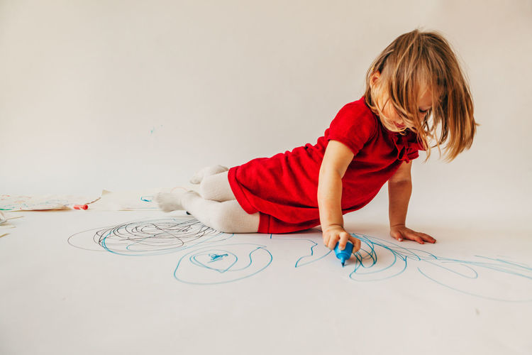 Girl drawing on white background