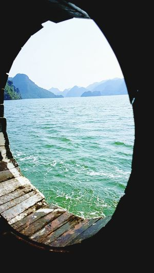 View from the window Ha Long Bay Cruise Ha Long Bay Ha Long Bay Halong Bay Emerald Waters Sea Mountain Water Nature No People Beach Scenics Outdoors Beauty In Nature Sky Close-up Day Boats And Water Boat's Window